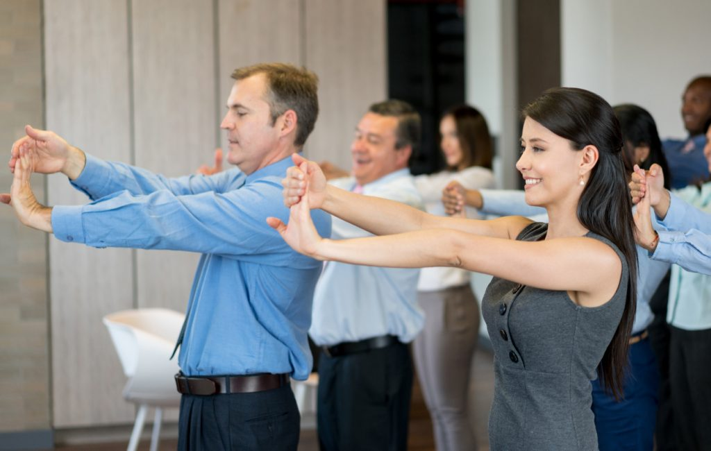 Employee satisfaction. Employees stretching.