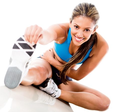 Woman doing cardio stretches or stretches before running.