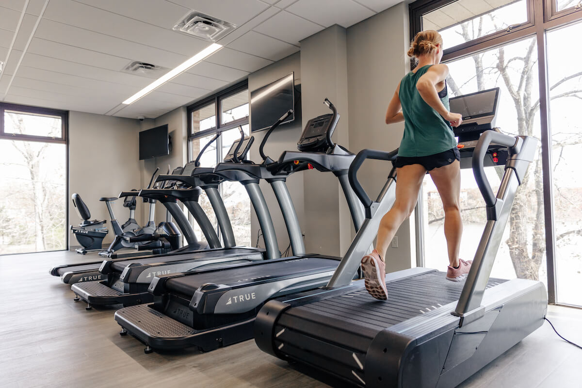 Woman running on the Stryker treadmill.