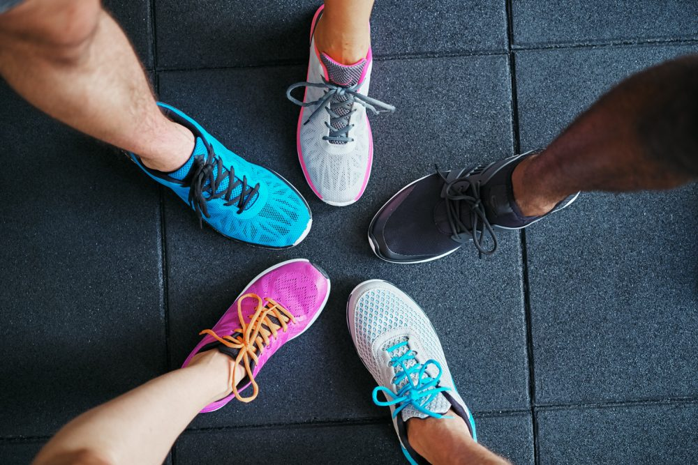 People with Running Shoes in the Middle True Cares True Shoes