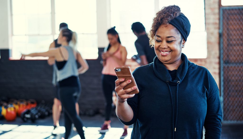 Woman excited that she has helped to create a successful wellness program.